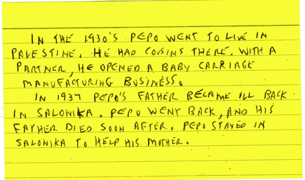 Yellow index card with handwriting in black ink.