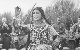 Uighur dancer performing to music.