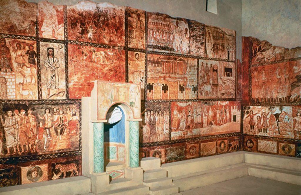 Color photograph of historic, mosaic-covered synagogue walls