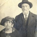 Photo of David and Kaden Alhadeff. They are both wearing hats; he is on the right standing and she is sitting at left.