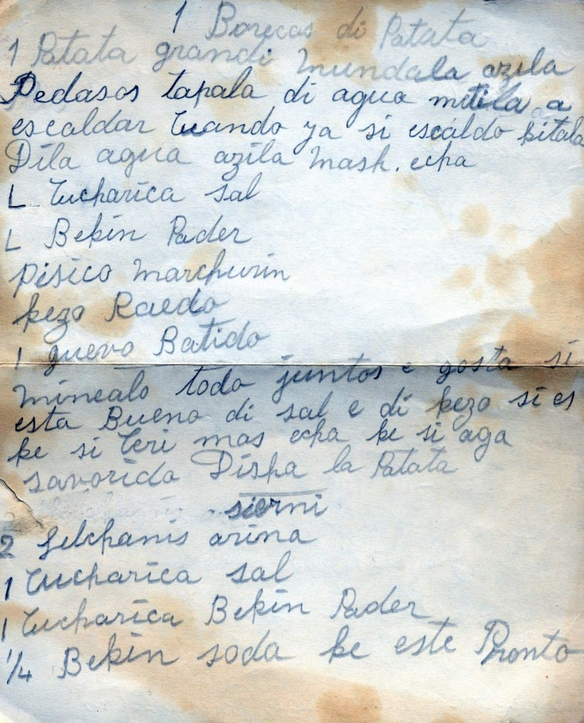 Handwritten Ladino recipe for borekas by Rachel Shemarya. Written in Latin letters on stained paper folded down the middle.