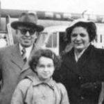 Black and white photo of Samuel, Aliza, and Judy Benaroya at Sea Tac airport.